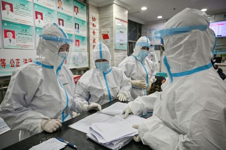 The spread of a deadly virus is overwhelming hospitals in Wuhan, the city at the epicentre of the health emergency (AFP Photo/Hector RETAMAL)