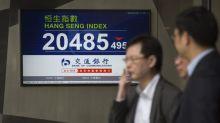 La Bolsa de Hong Kong pierde arrastrada por los títulos inmobiliarios