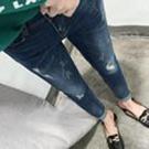 水洗刷色破洞牛仔直筒褲