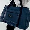 SKYBLUE自訂款,特殊設計可掛於行李箱拉桿不掉落,旅行袋拉鍊開口,附一長背帶可調整長度。