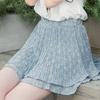 清新的碎花短裙揉合蛋糕層次,更散發出青春俏麗的氣息