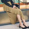 帶點輕熟感的波浪不規則荷葉長裙設計,優美的線條更顯女人味。