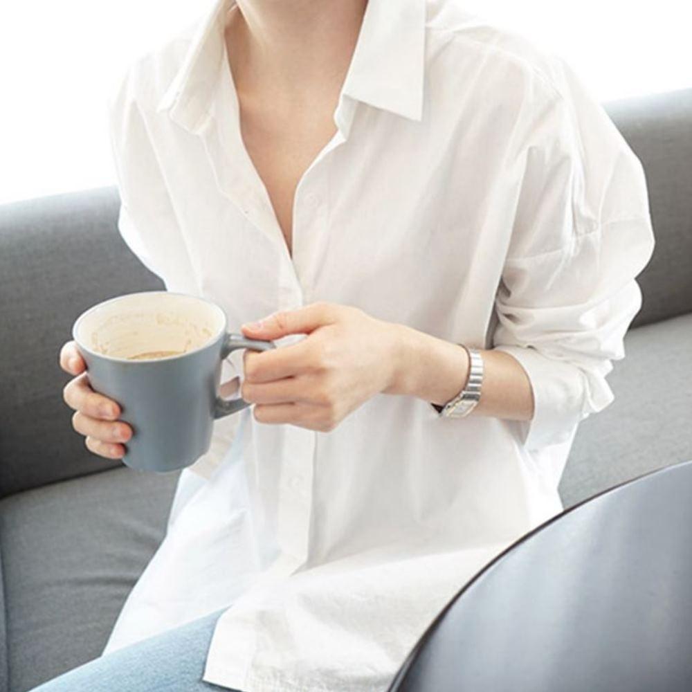 MOCO韓版百搭休閒寬鬆前短後長白色開釦襯衫M~2XL
