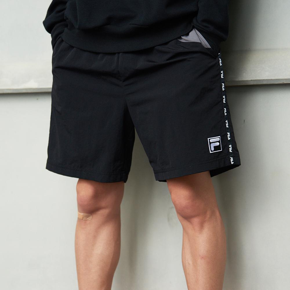 FILA #架勢新潮 平織短褲-黑色 1SHV-1443-BK