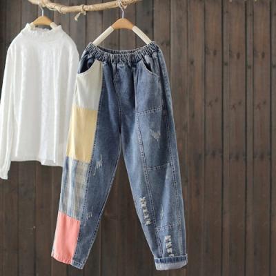 拼接撞色拉絲破洞鬆緊腰牛仔褲寬鬆長褲設計所在
