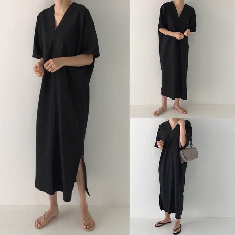 MOCO極簡主義大V領寬鬆慵懶風下擺側開叉棉麻長版洋裝