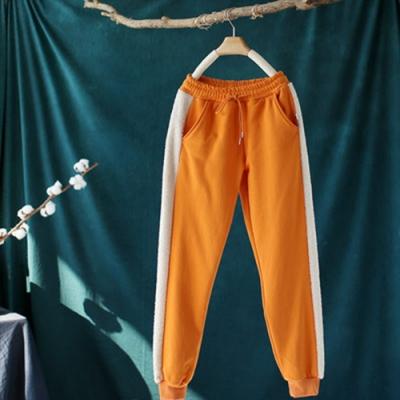 撞色毛絨拼接鬆緊腰束腳加絨運動衛褲寬鬆長褲-設計所在