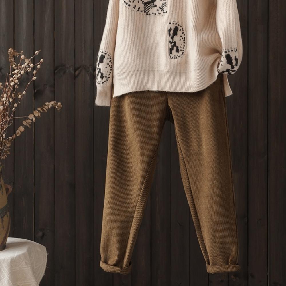 拼接雙腰設計條紋休閒哈倫九分褲-設計所在