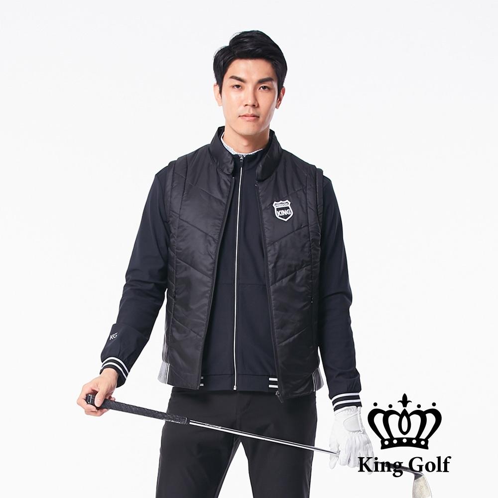 【KING GOLF】盾牌繡花下擺彈性剪接素面中厚款防風背心外套-黑色