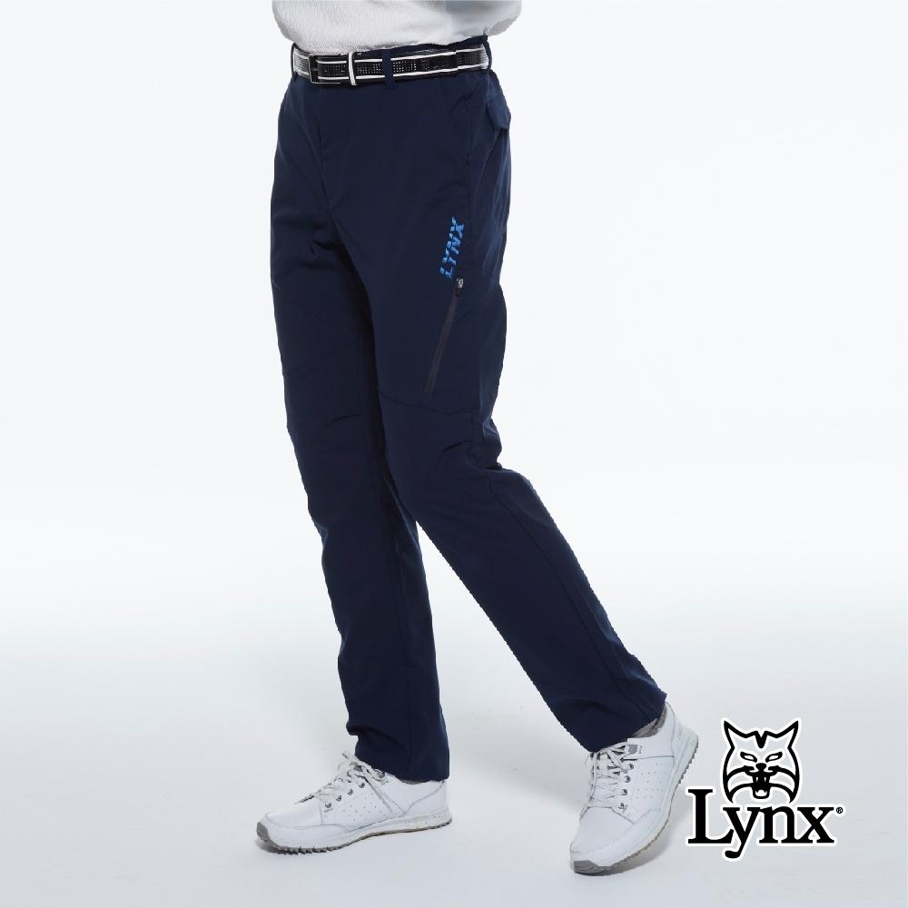 【Lynx Golf】男款瑞士3XDRY吸濕速乾防潑水素面大腿拉鍊設計平口休閒長褲-深藍色