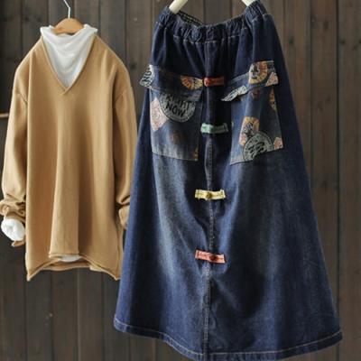 彩色盤扣拼接印花口袋牛仔裙鬆緊腰寬鬆中長裙-設計所在