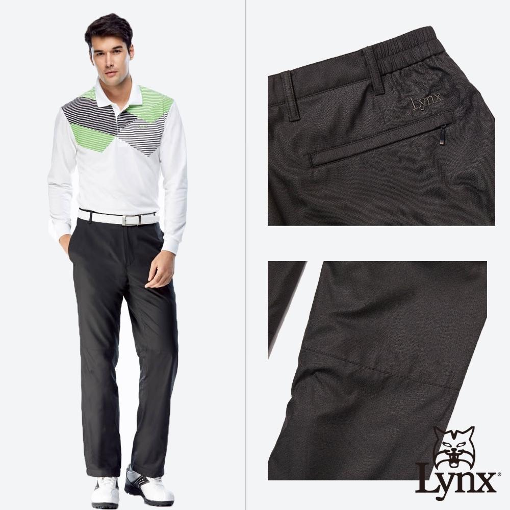 【Lynx Golf】男款防風防潑水內磨毛伸縮腰頭素面平口休閒長褲-黑色