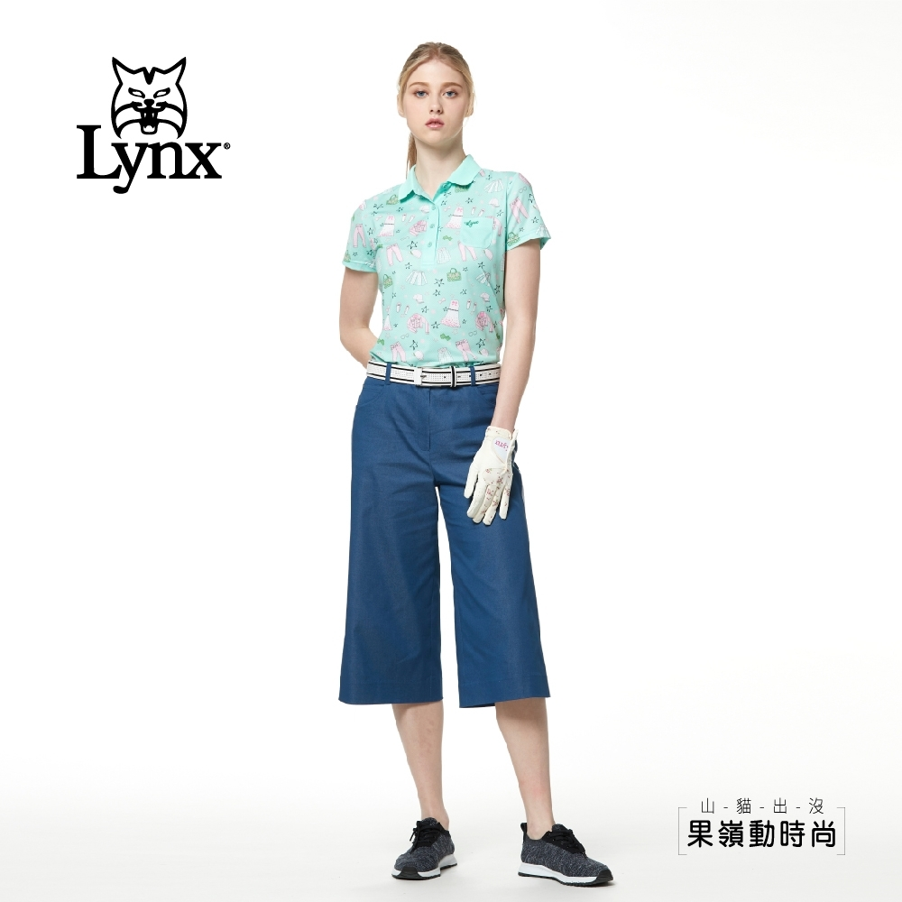 【Lynx Golf】女款日本進口布料側邊織帶口袋撞釘寬管七分褲-藍色