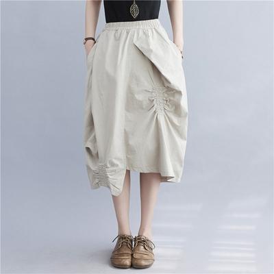 鬆緊腰有型不規則裙襬個性中裙-F(共二色)-Keer