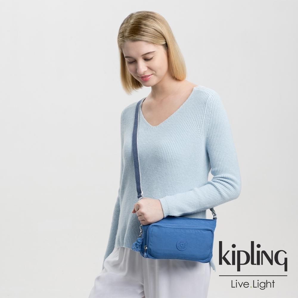 Kipling 經典海洋藍前袋拉鍊長形肩背包-MYRTE