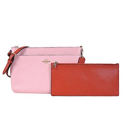 COACH撞色防刮皮革斜背包附零錢袋粉紅展示品