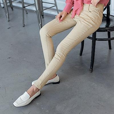 高含棉排釦設計彈力素面窄管褲-OB大尺碼