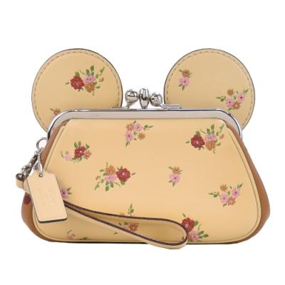 COACHxMINNIE米妮聯名款復古花印耳朵造型珠扣大手包(淺黃)