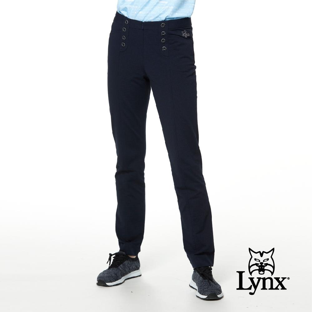 【Lynx Golf】女款日本進口布料裝飾縫扣隱形拉鍊直筒九分褲-深藍色