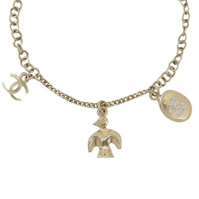 CHANEL 金幣飛鳥造型雙C LOGO吊飾手鍊(淡金)