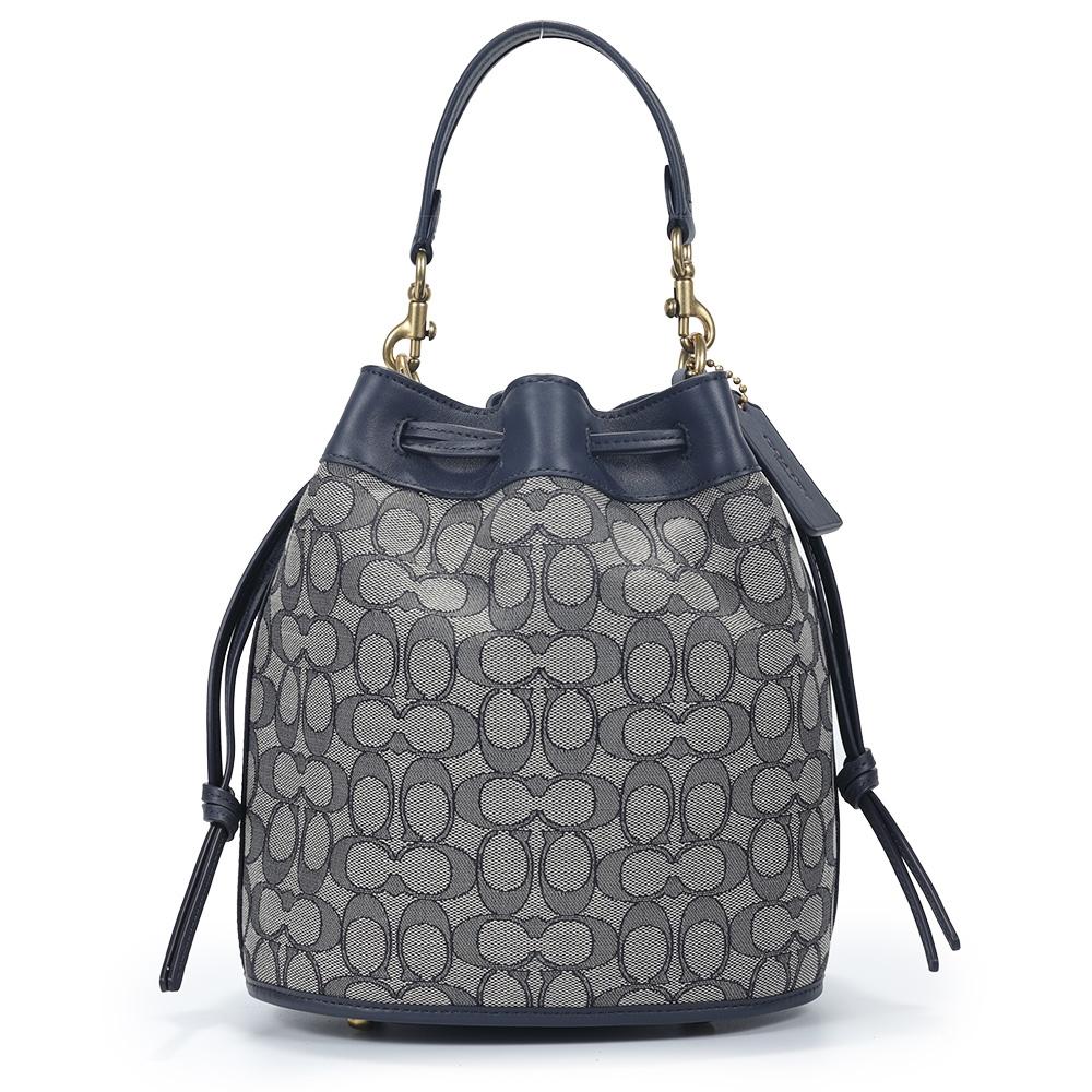 COACH FIELD BUCKET 經典C LOGO緹花紋拼接皮革寬版背帶手提/斜背兩用水桶包-藍黑色