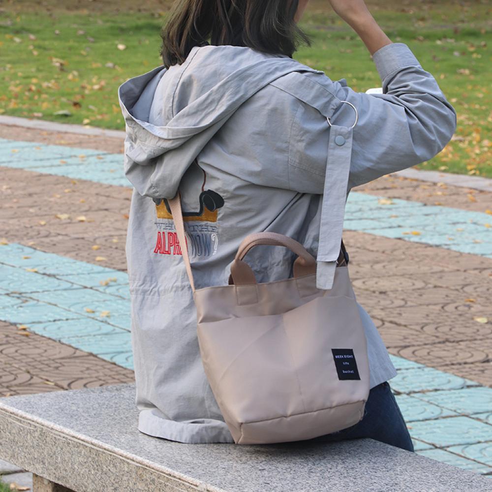 E.City_韓版防潑水多口袋手提斜挎水桶包
