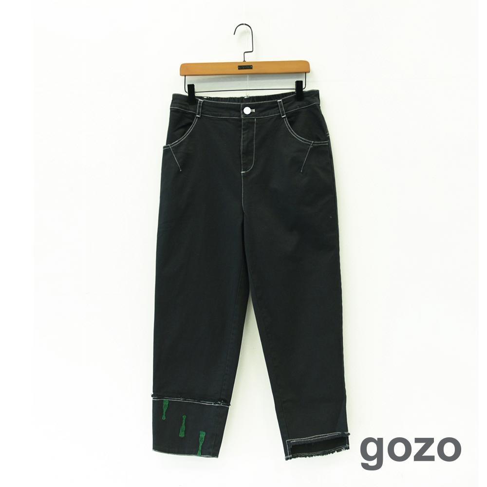 gozo 繡線畫具不對稱切口褲腳造型長褲(黑色)