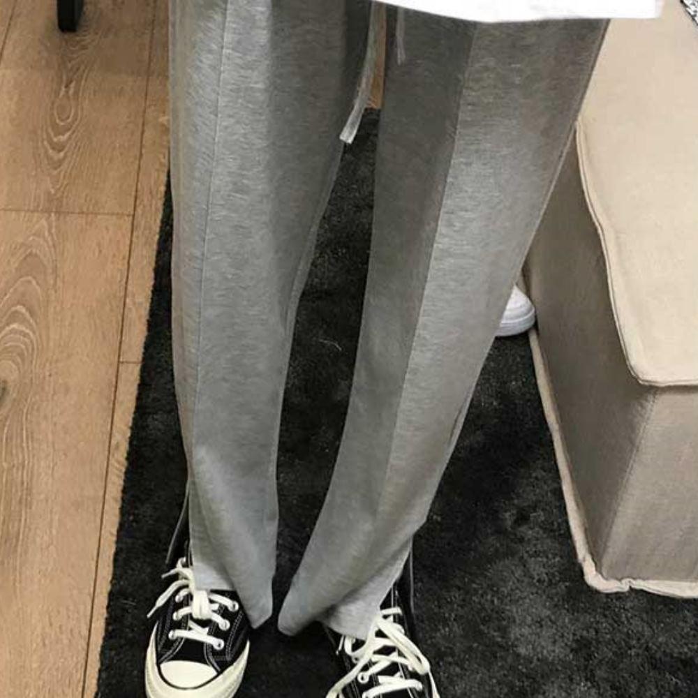 MOCO素色鬆緊腰抽繩褲管側開叉垂綴感羅紋棉質彈性休閒直筒褲L~4XL (灰色)