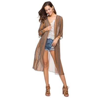 La Belleza荷葉喇叭袖幾何排列圖騰印花前綁結兩側開叉雪紡罩衫外套