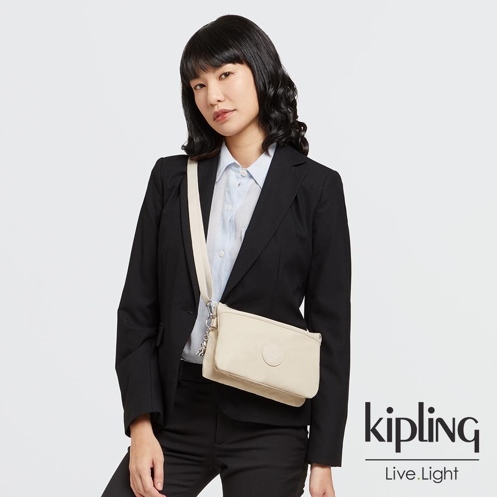 Kipling 閃亮象牙粉單肩隨身斜背包-RIRI