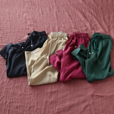 柔滑天絲哈倫顯瘦休閒開叉九分褲-設計所在