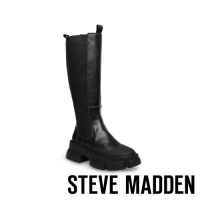 STEVE MADDEN-TRUCKER 個性款拼接皮質厚底長靴-黑色