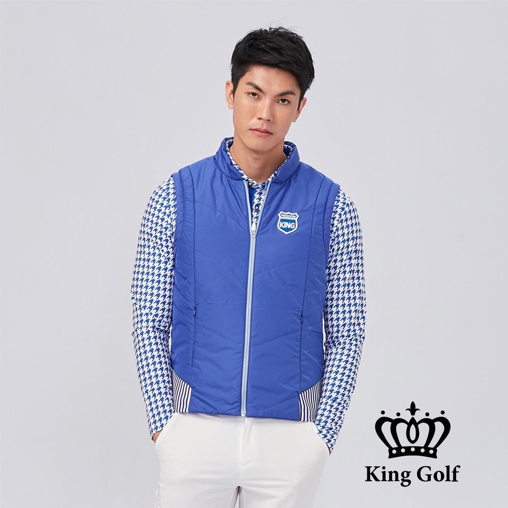 【KING GOLF】盾牌繡花下擺彈性剪接素面中厚款防風背心外套-藍色