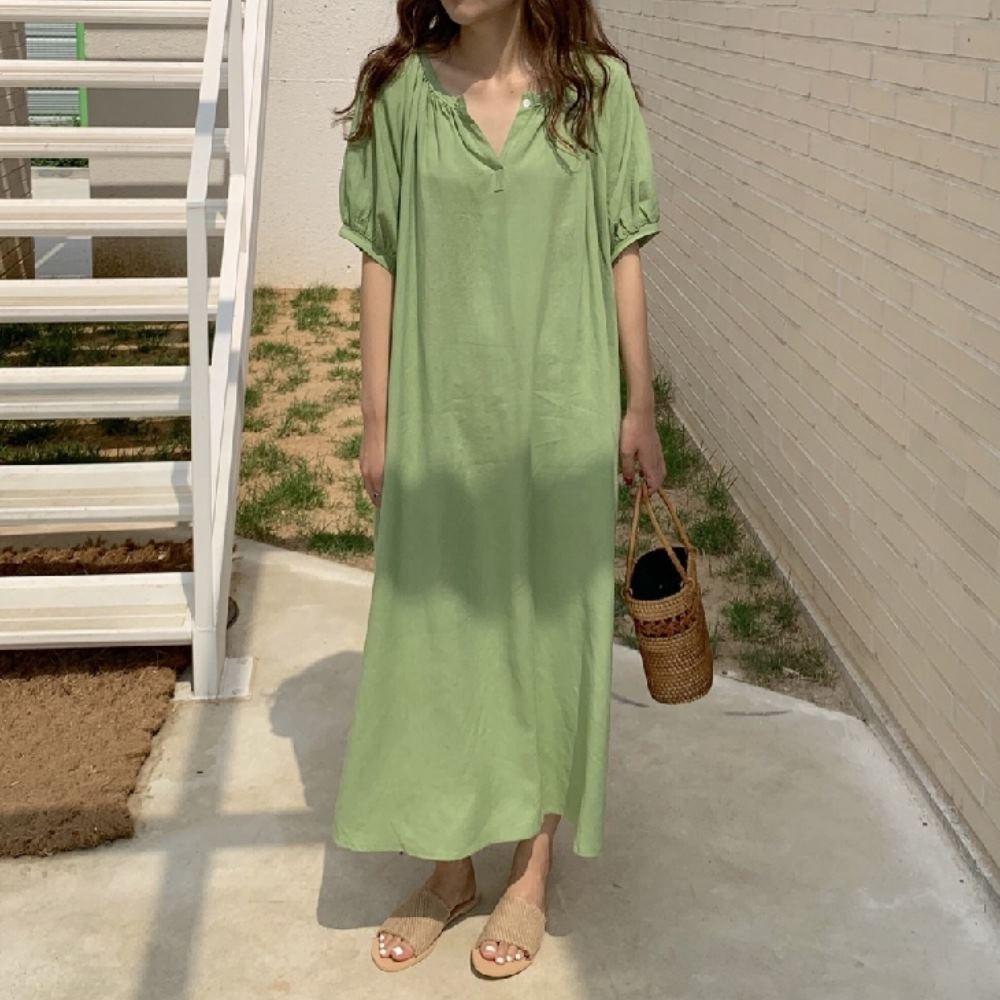 暢貨出清MOCO牛油果色極簡清爽寬鬆V領慵懶風繫帶棉麻側開叉長版洋裝