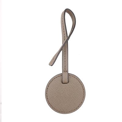 MICHAEL KORS LOGO刻字圓型防刮皮革吊飾(淺駝)