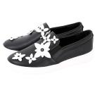 Michael Kors Lola 撞色花朵飾皮革平底休閒鞋(黑色)