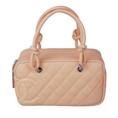 CHANEL小巧造型羊皮手提包(米)-展示品