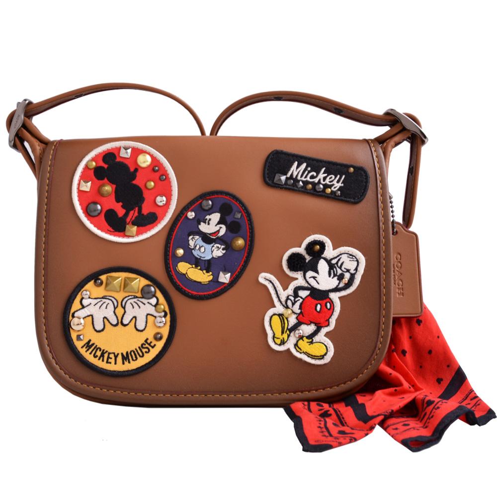 COACH X Disney米奇鉚釘徽章拼貼皮革斜背馬鞍包-大咖啡附米奇圖騰絲巾