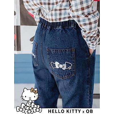 撲克KITTY刺繡圖樣高含棉牛仔縮口長褲-OB大尺碼