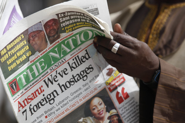 A man reads a local newspapers with the headline 'We've killed 7 foreign hostages' on a street in Kano, Nigeria, Sunday, March. 10, 2013. The United Kingdom's military says its warplanes recently spotted in Nigeria's capital city were there to move soldiers to aid the French intervention in Mali, not to rescue kidnapped foreign hostages. The Ministry of Defense said Sunday that the planes had ferried Nigerian troops and equipment to Bamako, Mali. An Islamic extremist group in Nigeria called Ansaru partially blamed the presence of those planes as an excuse for claiming Saturday that it killed seven foreign hostages it had taken. ( AP Photo/Sunday Alamba)