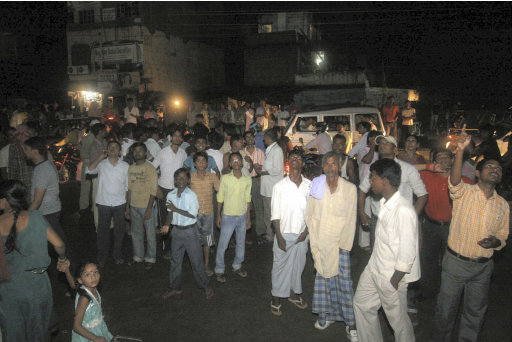 People who rushed out of buildings following tremors stand on the street in Patna, India, Sunday, Sept. 18, 2011. A strong earthquake with a preliminary magnitude of 6.8 hit northeastern India on Sunday near the border with Nepal. Reports said several people were injured and some buildings fell in the capital of India's Sikkim state. In neighboring Nepal and Bangladesh, the quake sent residents rushing out their homes, offices and shopping centers. (AP Photo) INDIA OUT