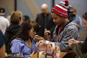 Buyers browse samples at Shango Cannabis shop on first…