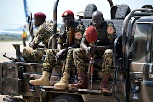 South Sudan's soldiers sit on a truck at the airport …