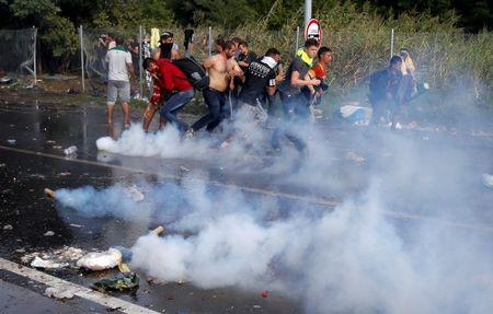 Hungarian riot police detain migrants, including 'terrorist'