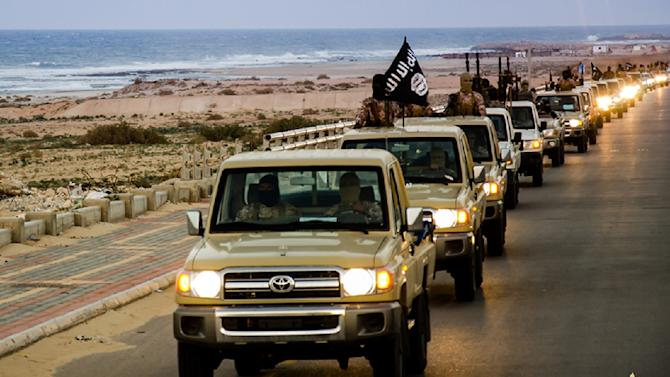 An image from Islamist media outlet Welayat Tarablos on February 18, 2015 allegedly shows members of the Islamic State group parading in a street in Libya's coastal city of Sirte