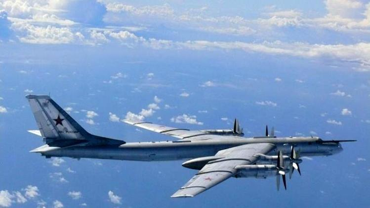 A Russian TU-95 bomber flies in airspace near the isle of Okinoshima in western Japan on August 22, 2013