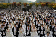 FILE - In this Wednesday, Oct. 14, 2009 file photo, couples from around the world participate in a mass wedding ceremony arranged by the Rev. Sun Myung Moon's Unification Church at Sun Moon University in Asan, south of Seoul, South Korea. Moon, self-proclaimed messiah who founded the Unification Church, has died at age 92 church officials said Monday, Sept. 3, 2012. (AP Photo/Lee Jin-man)