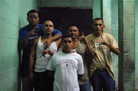 Gang members and inmates pose for a photograph at a prison in Quezaltepeque