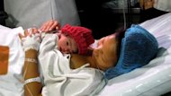 """The Philippines welcomes one of the world's symbolic """"seven billionth"""" babies, after she arrived to a celebratory cheer at a packed government-run hospital."""