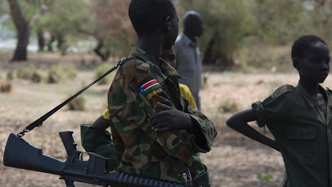 Young boys, children soldiers attend a ceremony marking the disarmament of child soldiers, their demobilisation and reintegration in Pibor, South Sudan on February 10, 2015